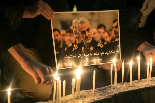 People light candles at a mourning ceremony for Qasem Soleimani in Tehran, January 2020 (Ahmad Halabisaz / Redux)