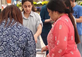 Deena Mousa (YC '20) walks customers through treatment surveys in a Carrefour grocery store in Doha, Qatar.